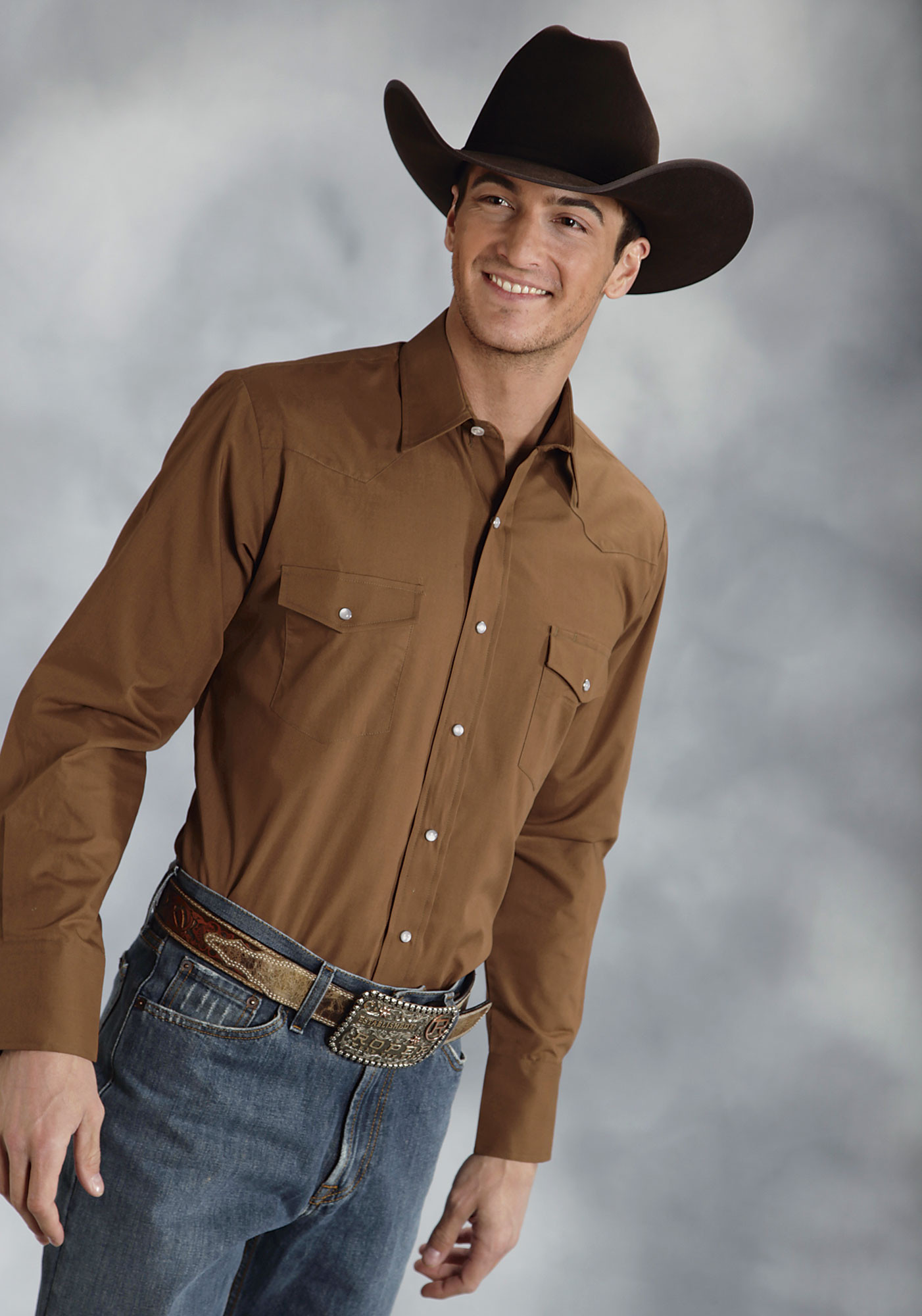 Pearl snap shirts are THE distinguishing feature of a Western shirt compared to standard ole shirts. Pearl snaps are designed to be beautiful, unique in color, and lustrous - just like the genuine, smooth mother-of-pearl lining in an oyster.